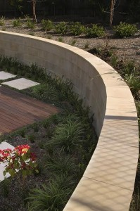 Sandstone wall and garden